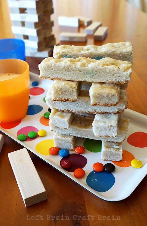 Make some M&M's® Surprise Cookie Bars for a fun Family Game Night snack. You can build with your game night cookies! #GameNightIn #Ad