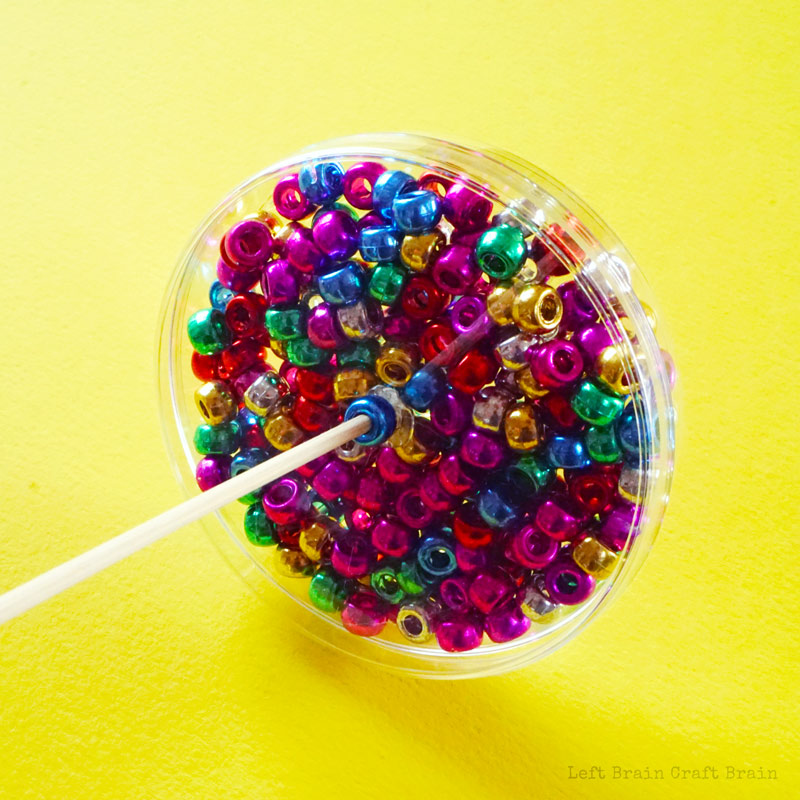 beads in petri dish with skewer.