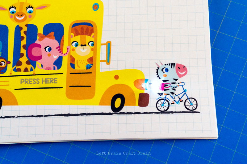 closeup of the LED in the light-up paper circuits school bus card