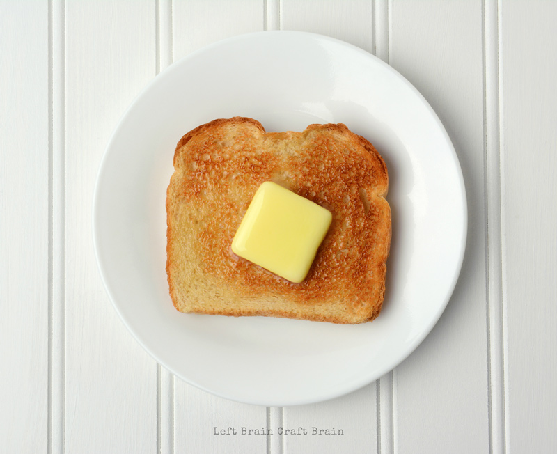 slice of toast with butter pat melting on top