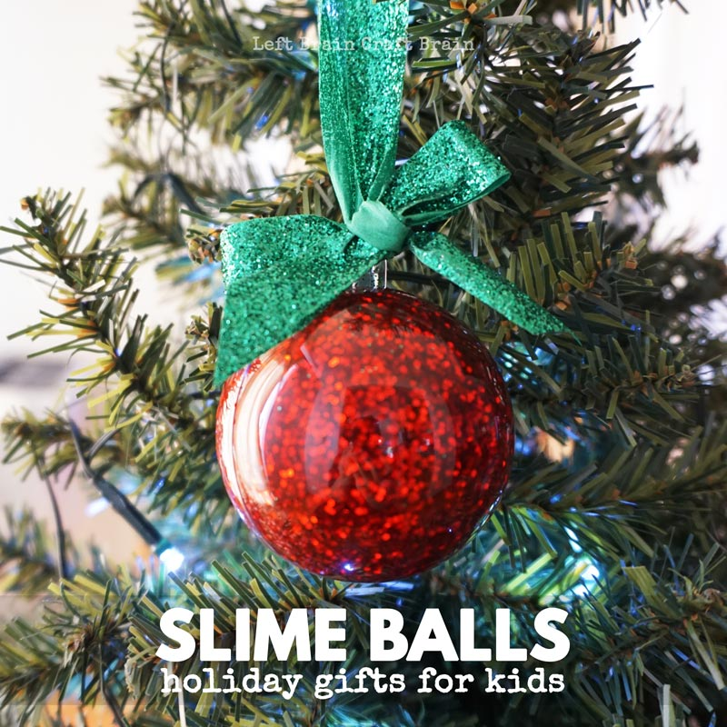 slime balls slime filled ornament hanging from ribbon on tree