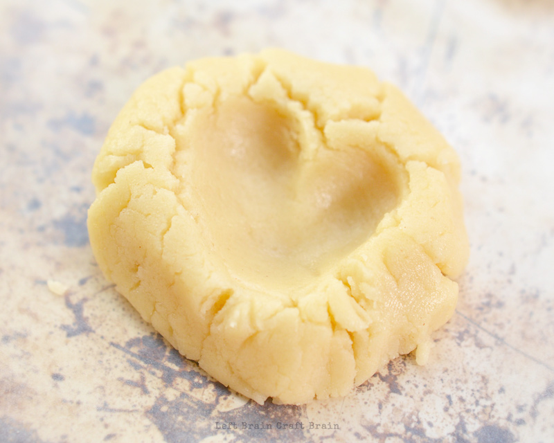 make a v shaped impression in cookie dough with finger
