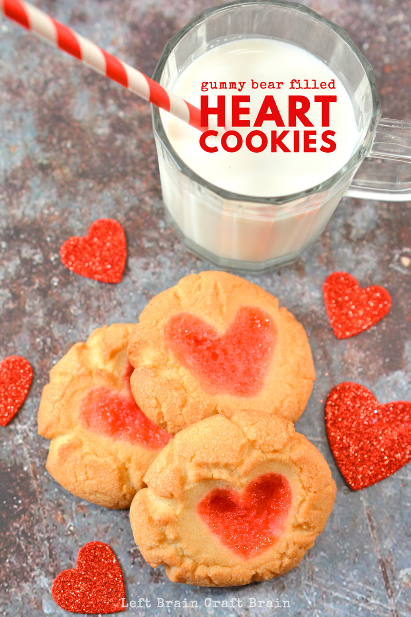 A sweet gummy bear candy surprise gives these sugar heart cookies a flavorful, chewy bite. Super Easy Gummy Bear Filled Heart Cookies are perfect for Valentine's Day, Christmas, or any day you're gifting some homemade cookies to someone you love.