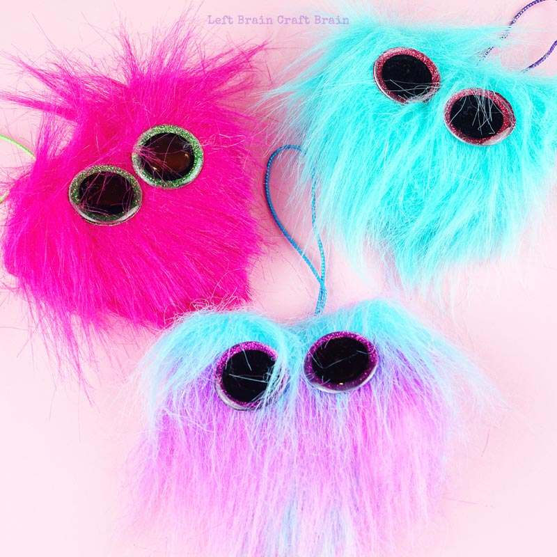 3 colors of fuzzy heart backpack charms closeup