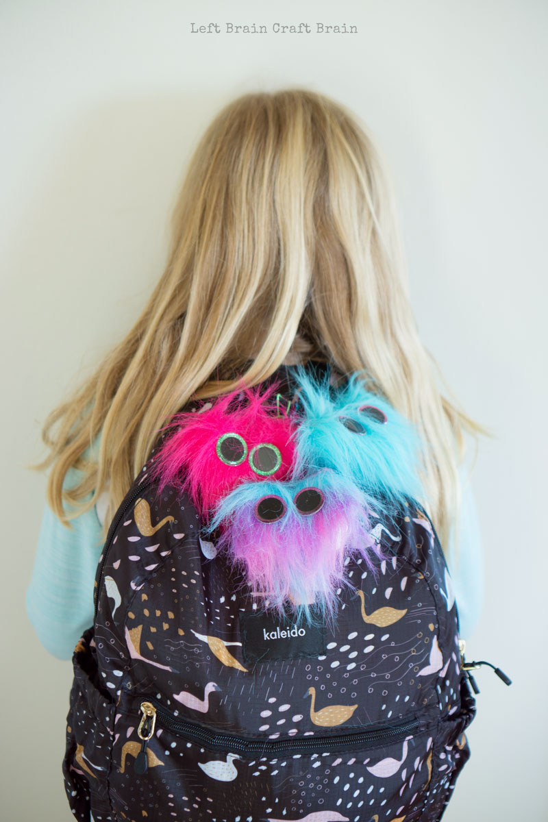 fuzzy heart backpack charms on backpack