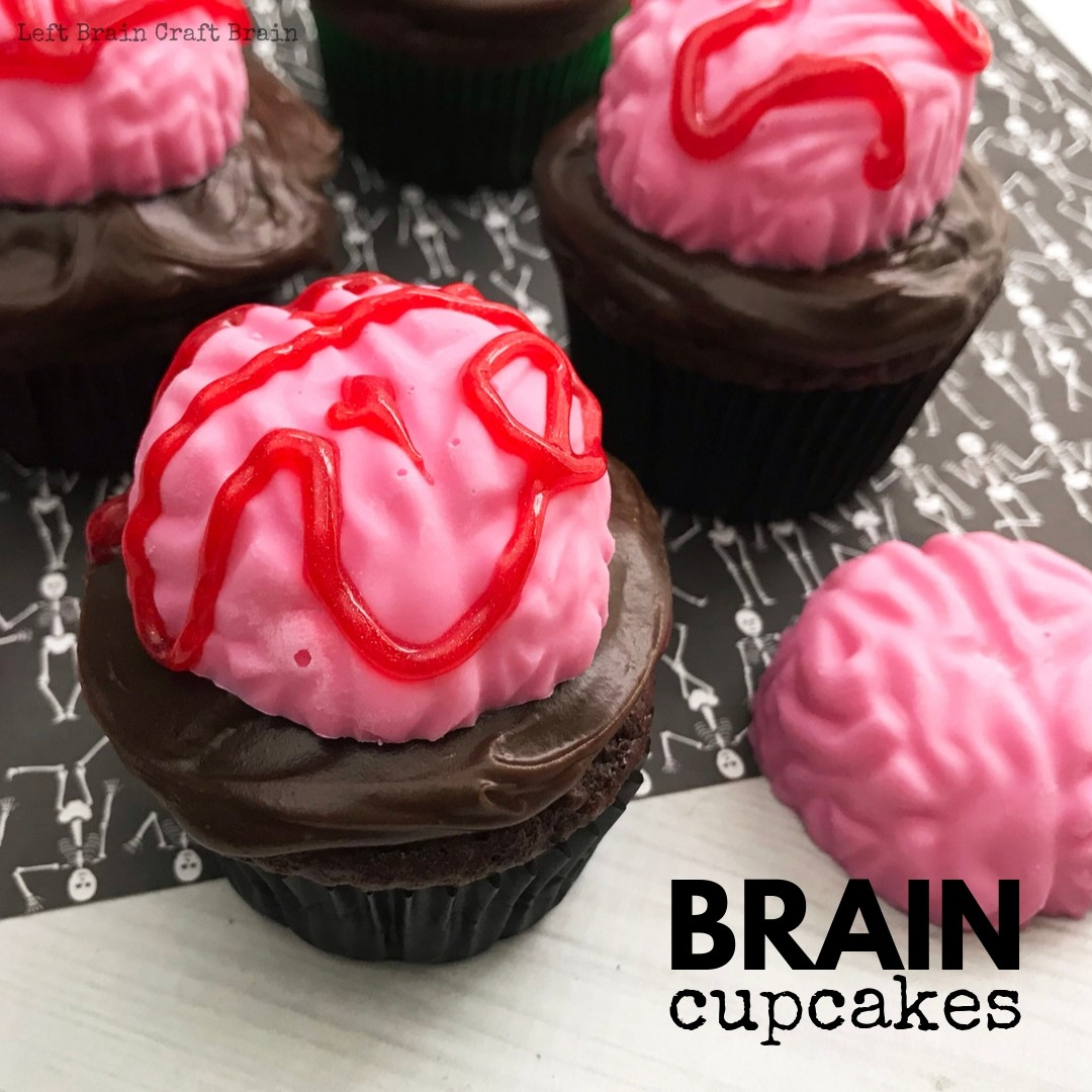 Bake these spooky Brain Halloween Cupcakes for your next Halloween party or zombie gathering. They're deliciously chocolate and easy to make with your favorite cake recipe or boxed cake mix. All you need is a brain mold, some candy melts, and red gel icing. these treats will add some scary sweet to your party table.