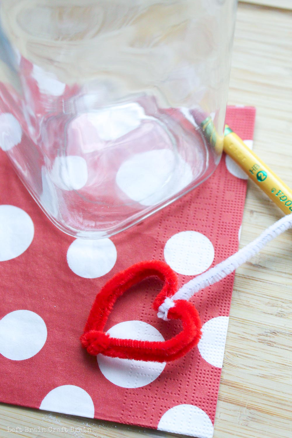 Attach the pipe cleaner heart to a pencil