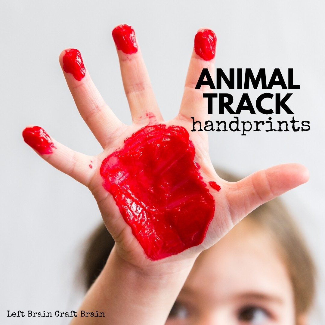 animal track handprints kid hand with red paint animal track on hand and fingers