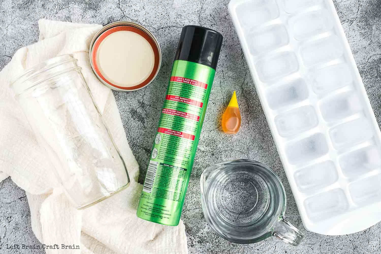 cloud in a jar supplies hair spray food coloring ice cub tray jar towel water