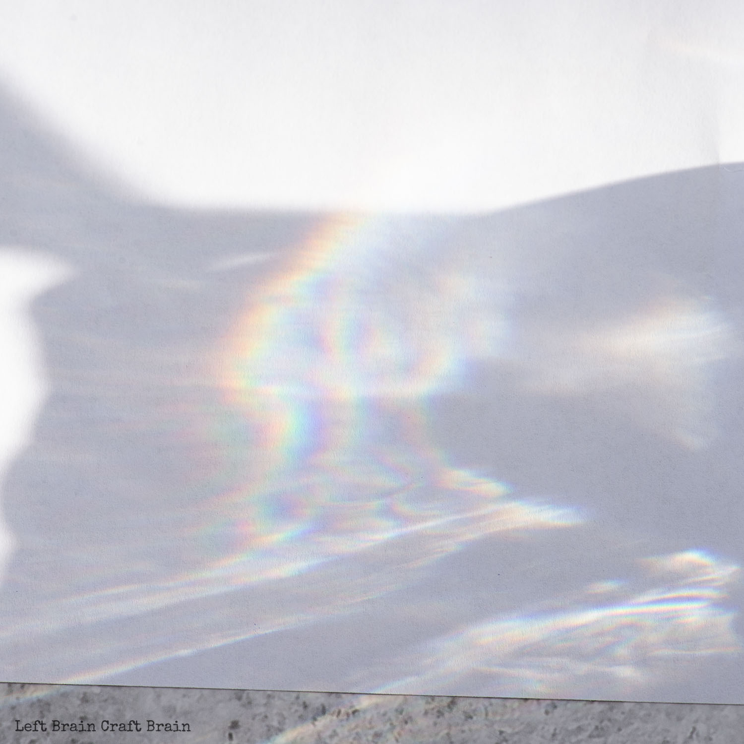 closeup of sunlight and rainbow on paper