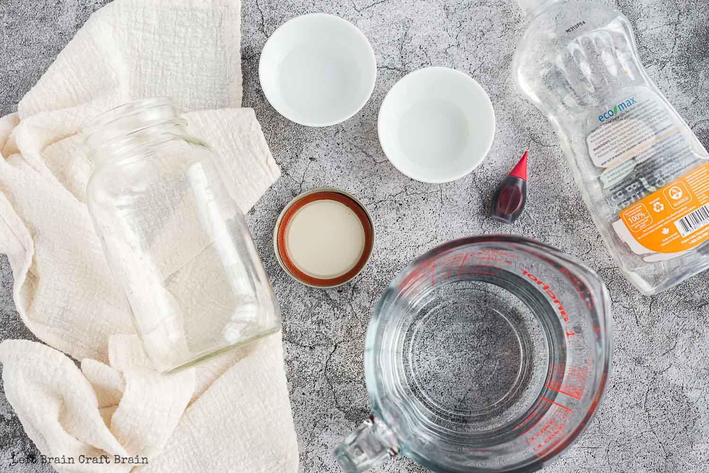 tornado in a jar supplies dish soap water in measuring cup jar with lid food coloring vinegar in bowl