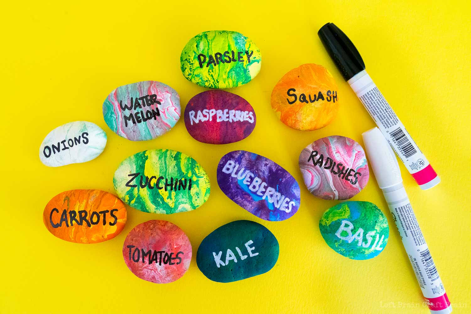 lots of labeled pour painted rock garden markers with paint pens