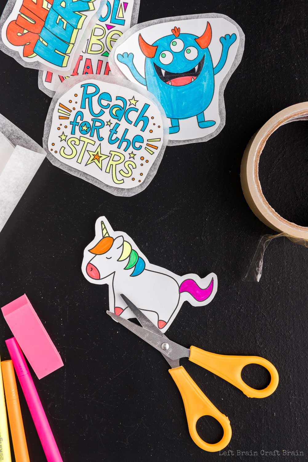 cut out the unicorn for the DIY stickers - Make your own DIY stickers with a super easy process using basic supplies. Kids will love this activity. They're fun to add to presents, too.