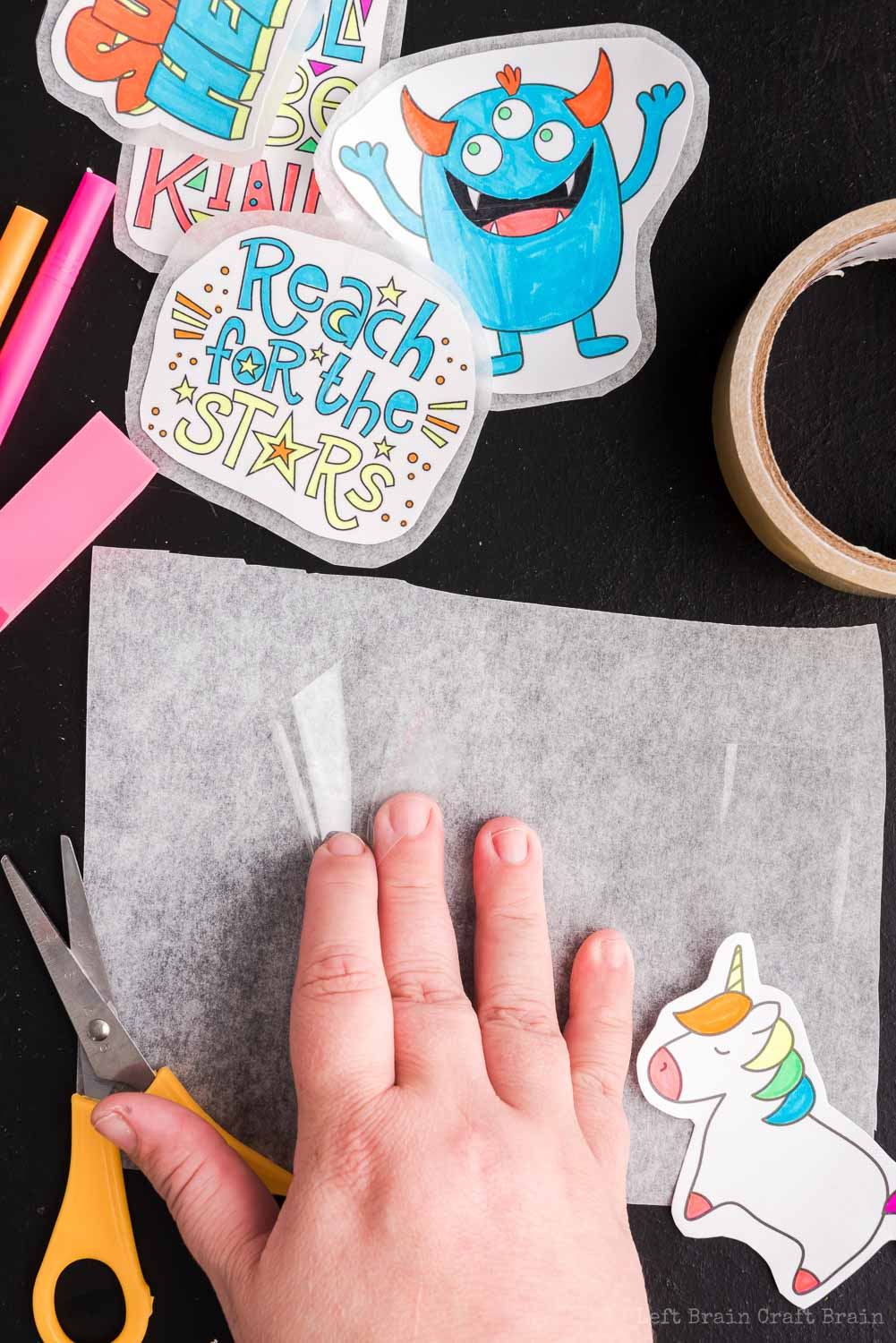 Place first layer of tape for stickers - Make your own DIY stickers with a super easy process using basic supplies. Kids will love this activity. They're fun to add to presents, too.