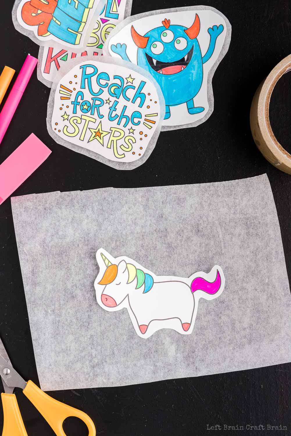 Lay design on tape - Make your own DIY stickers with a super easy process using basic supplies. Kids will love this activity. They're fun to add to presents, too.