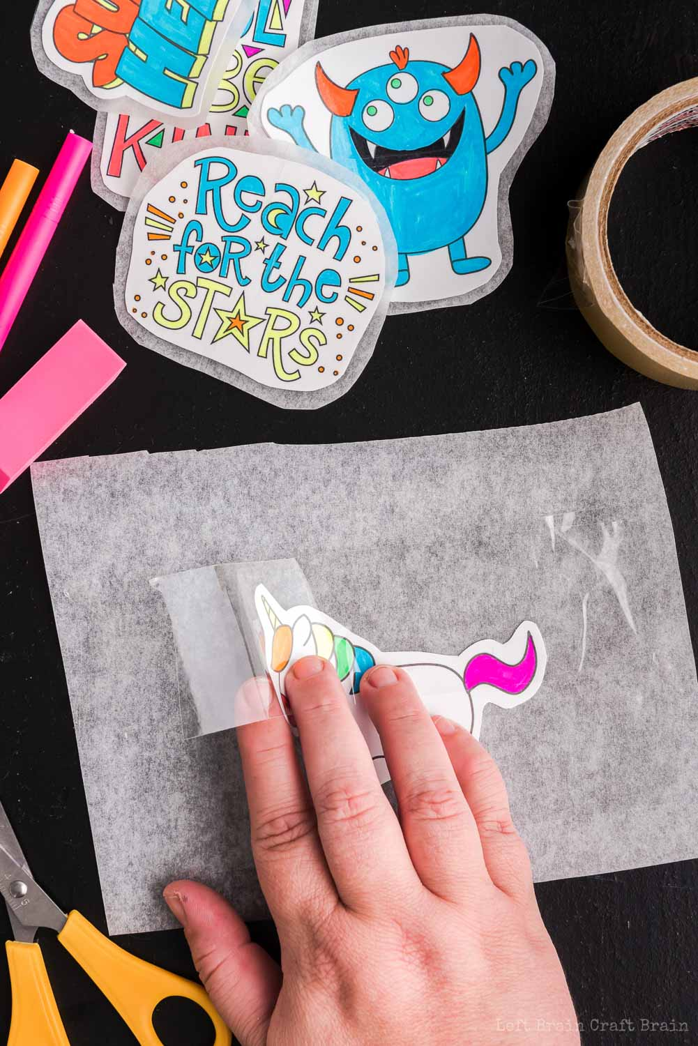 Place clear tape over design - Make your own DIY stickers with a super easy process using basic supplies. Kids will love this activity. They're fun to add to presents, too.