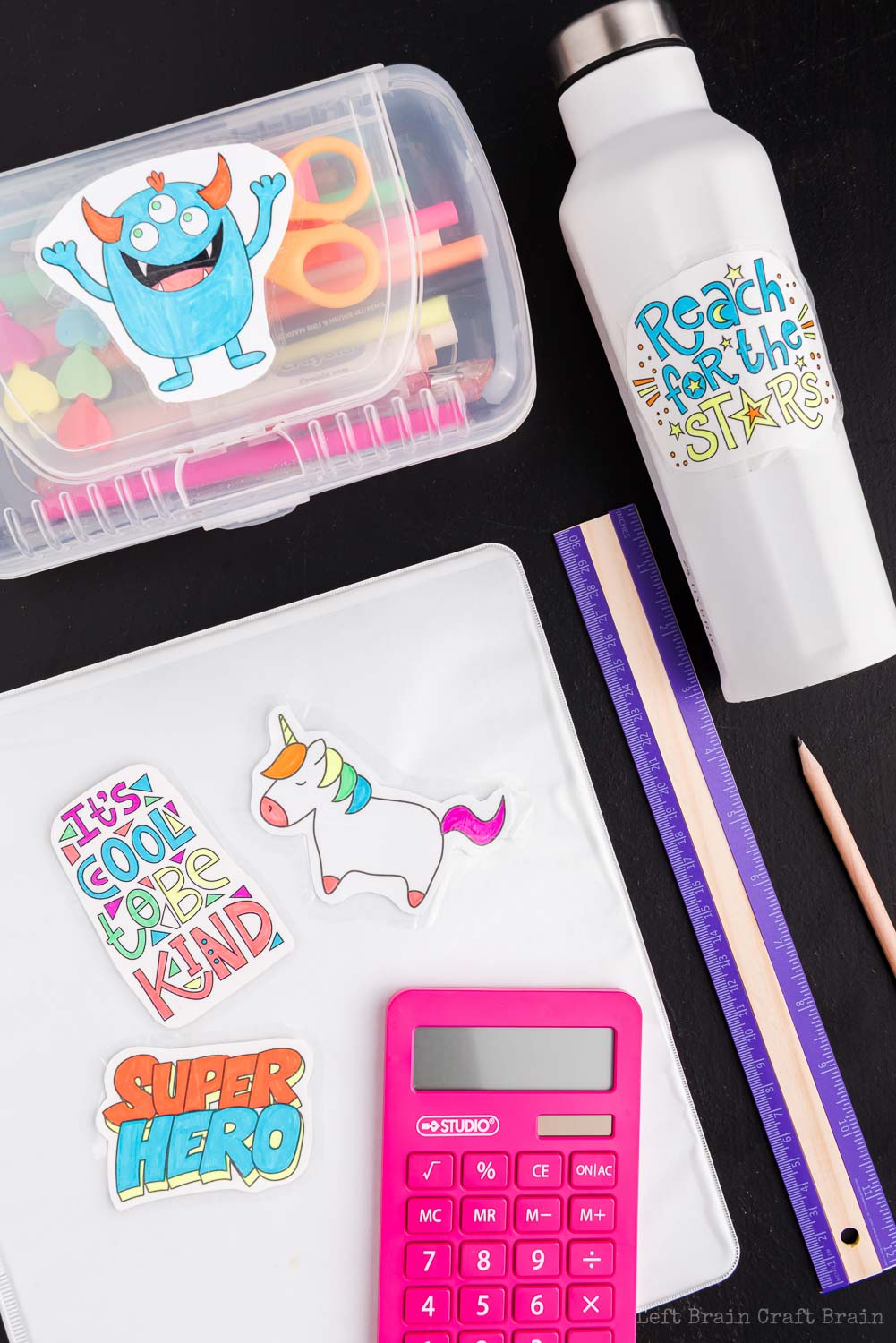 DIY stickers on pencil case, water bottle, binder with ruler and calculator