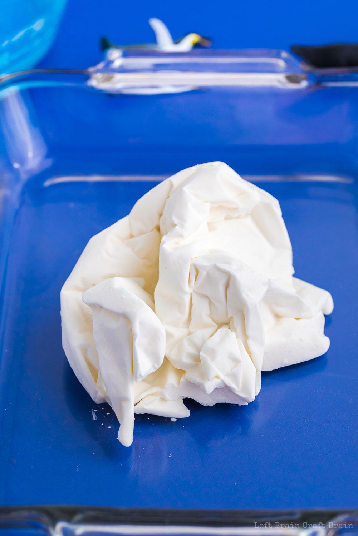 white frozen oobleck iceberg in glass tray