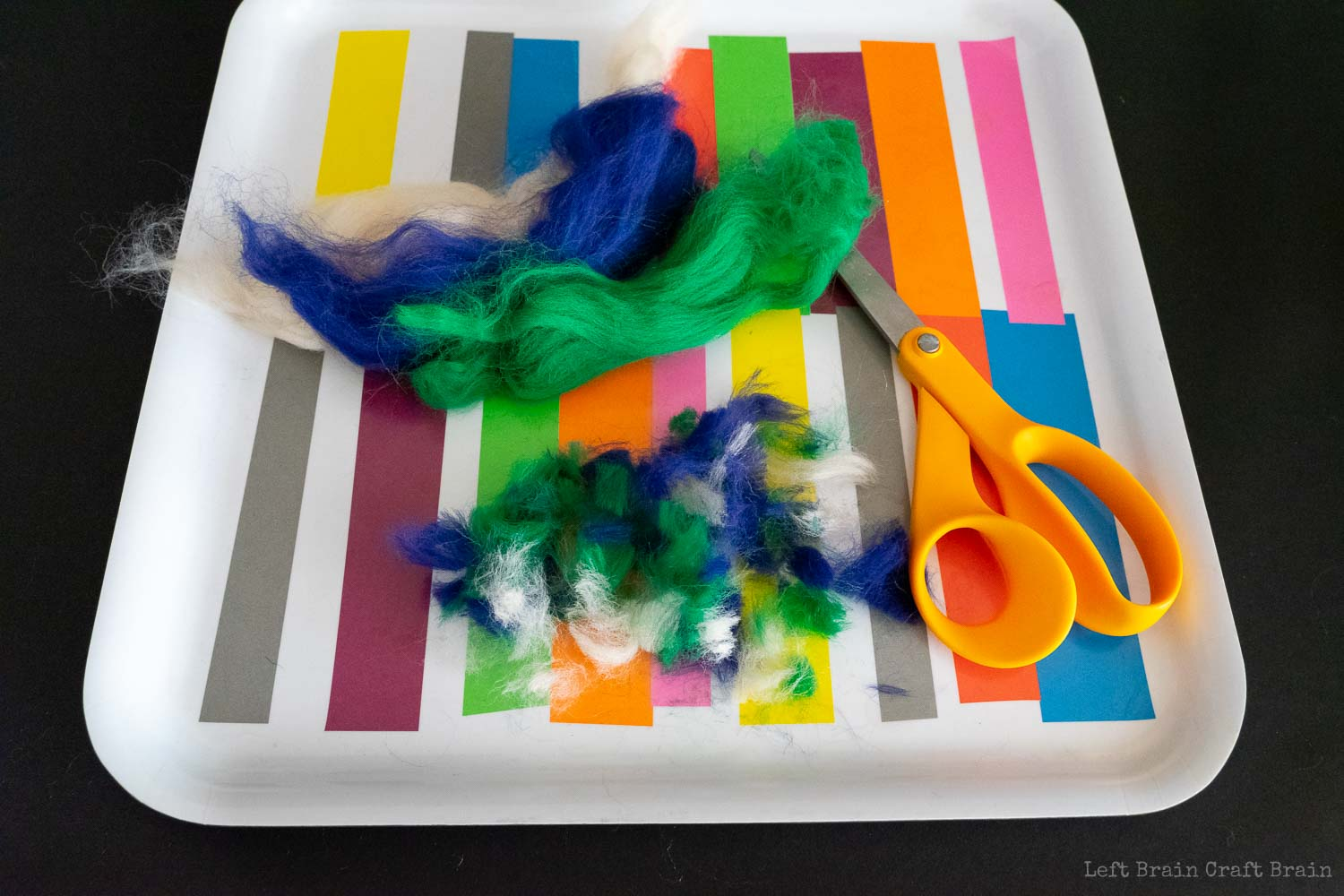 snip multiple colors of wool roving into pieces