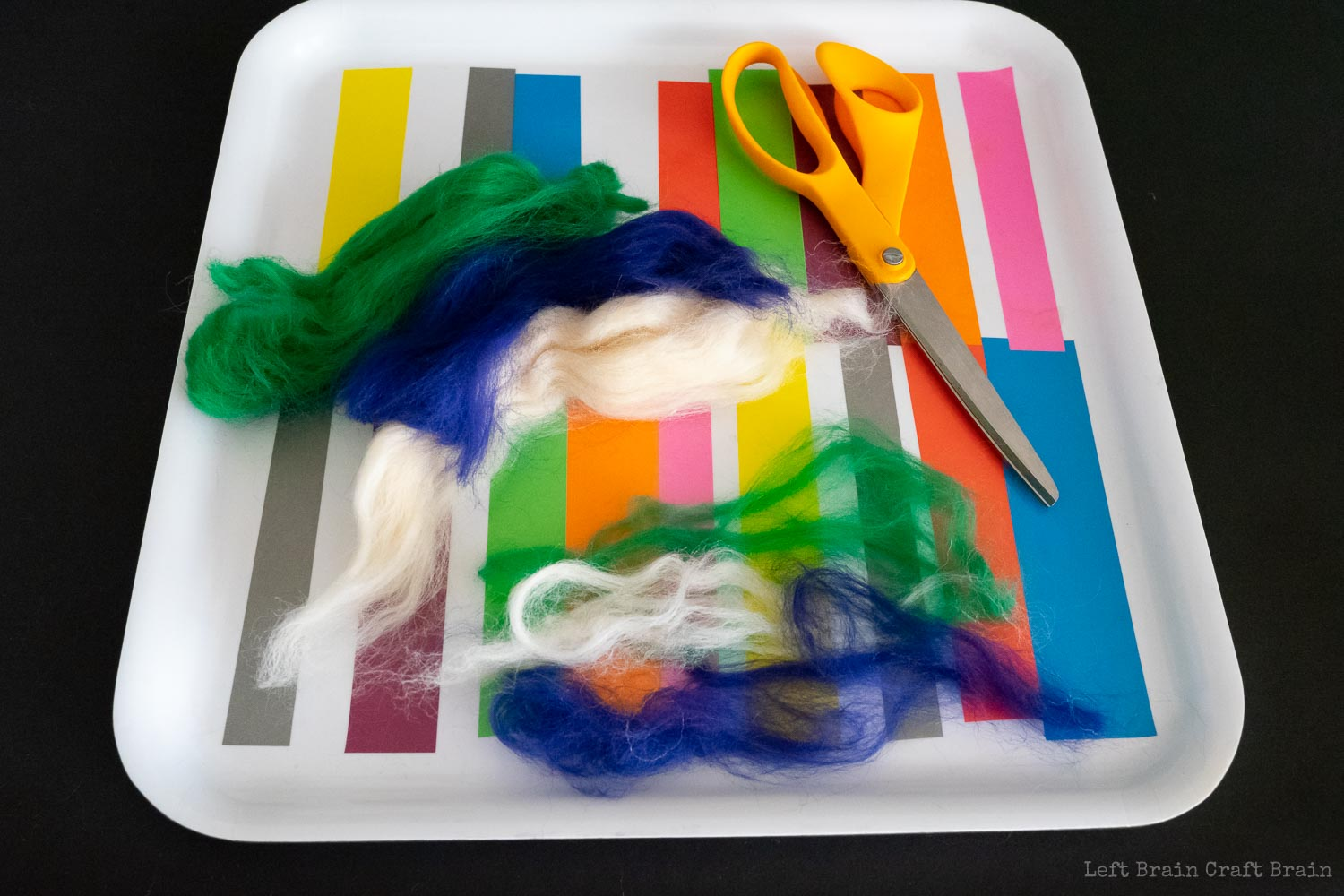 pull strands of multiple colors into long pieces to make striped felt balls