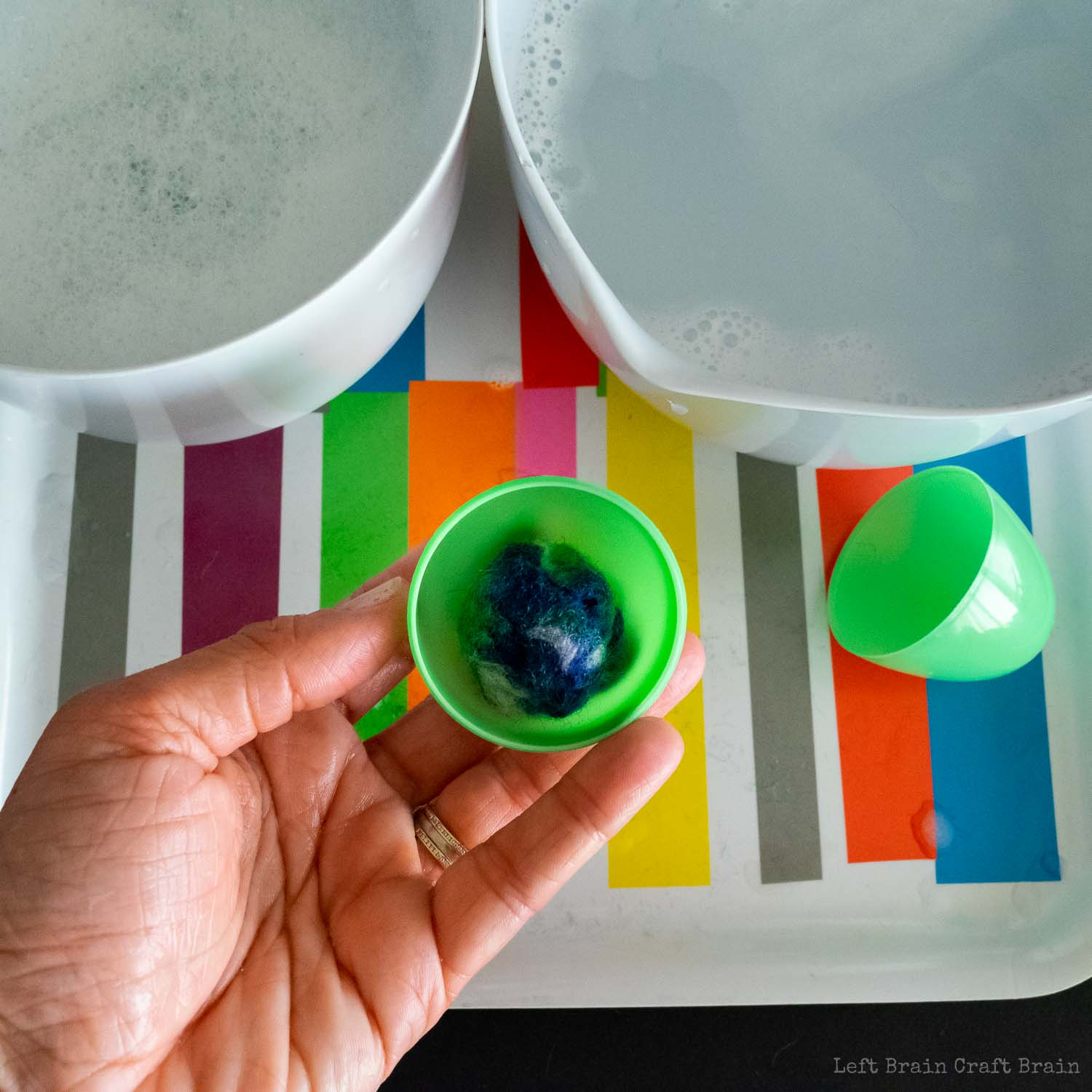 place ball of wool roving into plastic easter egg